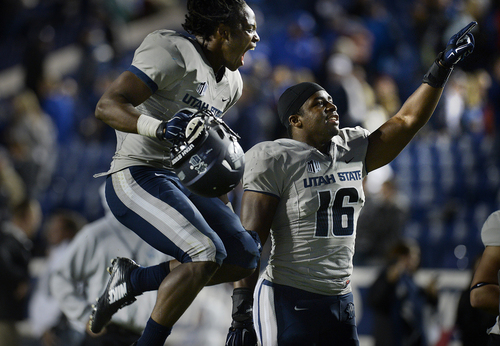 Scott Sommerdorf     The Salt Lake Tribune Utah State Aggies safety Devin Centers, left, and teammate LB Anthony Williams celebrate the win over BYU. Utah State defeated BYU 35-20 in Provo, Friday, October 1, 2014.