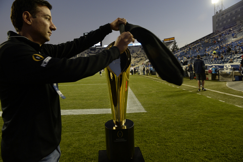 Scott Sommerdorf     The Salt Lake Tribune The National Championship trophy was unpacked and put on display on the field during pre game warmups before BYU plays Utah State in Provo, Friday, October 1, 2014.