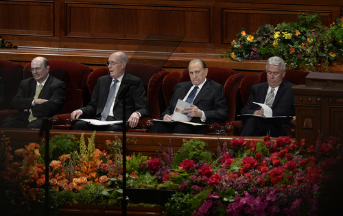 Scott Sommerdorf  |  The Salt Lake Tribune President Thomas S. Monson, second from right, reviews papers prior to the opening of the 184th Semiannual General Conference of The Church of Jesus Christ of Latter-day Saints, Sunday, October 5, 2014.