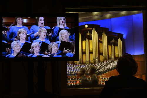 Scott Sommerdorf  |  The Salt Lake Tribune A TV showing the Tabernacle Choir juxtaposes with the view of the conference center at the afternoon session of the 184th Semiannual General Conference of The Church of Jesus Christ of Latter-day Saints begins, Sunday, October 5, 2014.