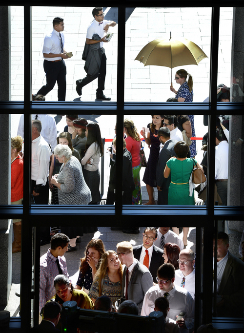 Scott Sommerdorf  |  The Salt Lake Tribune People stand in line to enter for the afternoon session of the 184th Semiannual General Conference of The Church of Jesus Christ of Latter-day Saints, Sunday, October 5, 2014.