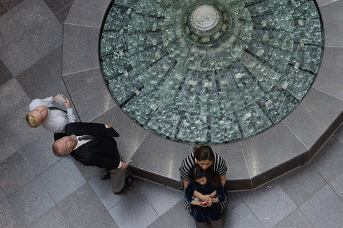 Scott Sommerdorf  |  The Salt Lake Tribune Two men look up to see the view of the glass artwork at the top of the Conference Center as two women hold each other near the fountain prior to the afternoon session of the 184th Semiannual General Conference of The Church of Jesus Christ of Latter-day Saints, Sunday, October 5, 2014.