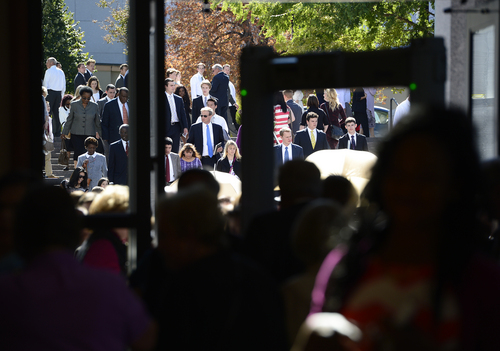 Scott Sommerdorf  |  The Salt Lake Tribune People make their way to the Conference Center for the afternoon session of the 184th Semiannual General Conference of The Church of Jesus Christ of Latter-day Saints, Sunday, October 5, 2014.