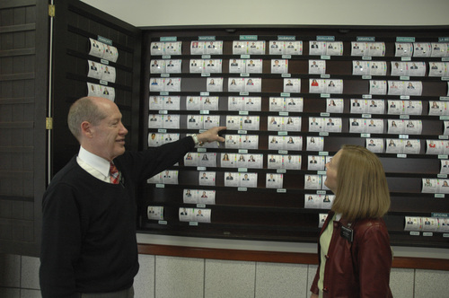 (Courtesy Intellectual Reserve)  President David and Sister Paula Henderson currently preside in the Huancayo Mission and study the assignments board to determine placement of the newly arriving missionaries.