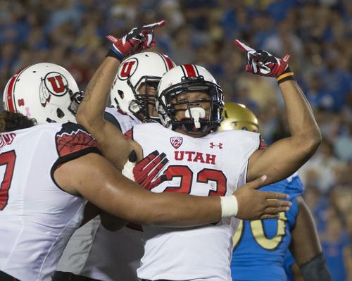 Rick Egan     The Salt Lake Tribune  Utah Utes running back Devontae Booker (23) celebrates his 3rd quarter touchdown, giving Utah a 24-14 lead over UCLA, at the Rose Bowl in Pasadena, Saturday, October 4, 2014