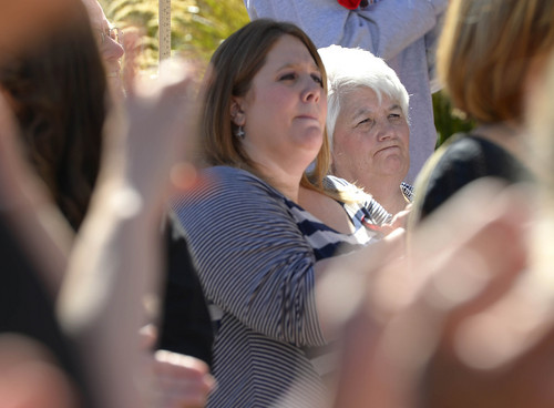 Leah Hogsten  |  The Salt Lake Tribune l-r Melinda Castallanos spoke on behalf of her father and mother Jana Tucker (right) about her brother Joey Tucker's shooting death in August 2009 at the Families Speak Out On Police Violence rally Saturday, October 4, 2014, at the Matheson Courthouse.