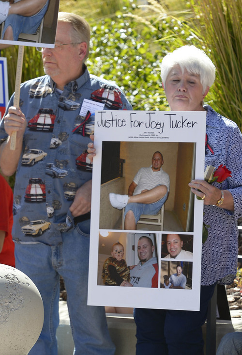 Leah Hogsten     The Salt Lake Tribune Perry and Jana Tucker listen to their daughter Melinda Castellanos talk about her brother Joey Tucker's shooting death in August 2009 at the Families Speak Out On Police Violence rally Saturday, October 4, 2014, at the Matheson Courthouse.