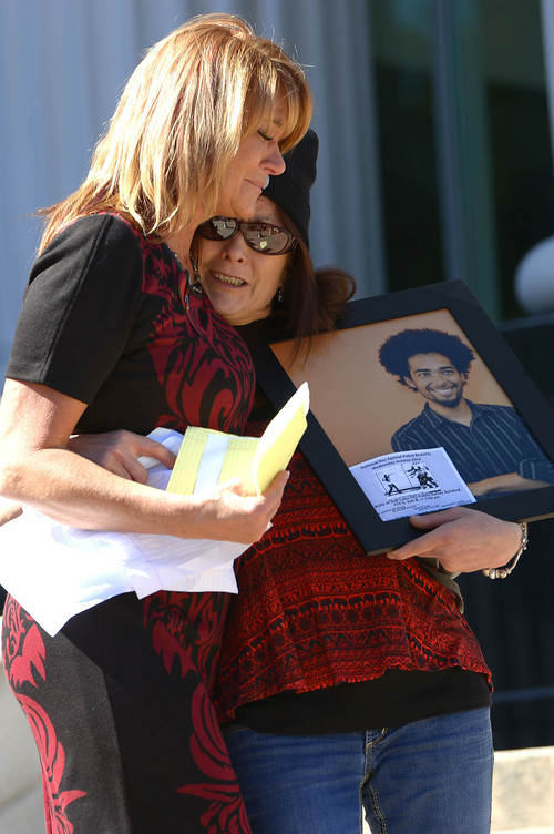Leah Hogsten  |  The Salt Lake Tribune Sisters Cindy Moss, left, and Susan Hunt bear hug each other after Moss' speech to the crowd about the shooting death of Hunt's son, Darrien Hunt at the Families Speak Out On Police Violence rally on Saturday at the Matheson Courthouse.