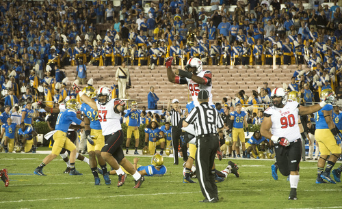 Rick Egan  |  The Salt Lake Tribune  The Utes celebrate what they thought was a victory but the pay was called back because of a roughing-the-kicker penalty. The Utes held on for a  30-28 upset over UCLA in Pac-12 action at the Rose Bowl, Saturday, October 4, 2014