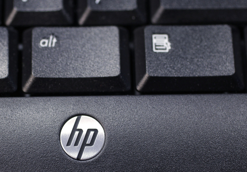 FILE - This Nov. 14, 2011 photo, shows the company logo on a Hewlett-Packard keyboard at the Micro Center computer store in Santa Clara, Calif. Hewlett-Packard on Monday, Oct. 6, 2014 said it is splitting itself into two companies, one focused on its personal computer and printing business and another on technology services, such as data storage, servers and software, as it aims to drive profits higher. (AP Photo/Paul Sakuma, File)