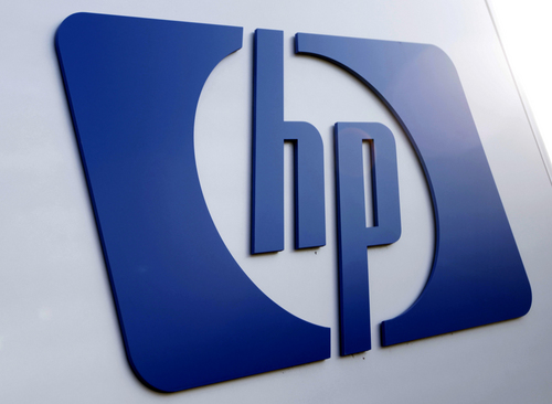 FILE - This Feb 21, 2012 file photo shows a Hewlett Packard logo in Frisco, Texas. Hewlett-Packard on Monday, Oct. 6, 2014 said it is splitting itself into two companies, one focused on its personal computer and printing business and another on technology services, such as data storage, servers and software, as it aims to drive profits higher. (AP Photo/LM Otero, File)