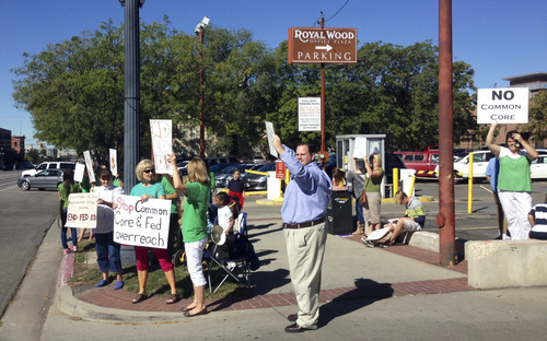 Benjamin Wood  |  The Salt Lake Tribune  Common Core opponents protest federal intrusion into Utah schools outside of the Royal Wood Office Plaza in Salt Lake City on Thursday, Sept. 25, 2014.