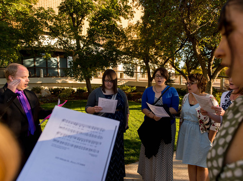Trent Nelson  |  The Salt Lake Tribune A group of people sing an LDS hymn before entering a broadcast of the LDS general priesthood session at BYU's Marriott Center in Provo Saturday October 4, 2014. The event was one of several planned by Ordain Women. Left to right, Zachary Noyce, Ellen Koester, Analisa Estrada, Cheryl Holdaway.