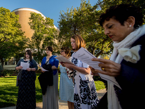 Trent Nelson  |  The Salt Lake Tribune A group of people sing an LDS hymn before entering a broadcast of the LDS General Conference priesthood session at BYU's Marriott Center in Provo Saturday October 4, 2014. The event was one of several planned by Ordain Women.