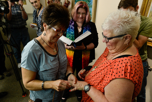 Francisco Kjolseth  |  The Salt Lake Tribune Sheri Ault, left, and her partner of 18 years, Leslie McWilliams, are married by Reverend Heron (Tara Sudweeks Willgues) moments after getting their marriage license at the Salt Lake County Complex on Monday. The U.S. Supreme Court declined to review all five pending same-sex marriage cases on Monday, Oct. 6, 2014 effectively legalizing gay and lesbian unions, clearing the way for such marriages to proceed in 11 new states - including Utah.