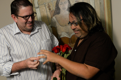Francisco Kjolseth  |  The Salt Lake Tribune Gregory Enke, left, places the ring on the finger of his partner of eight years Ariel Ulloa at the Salt Lake County Complex on Monday after being married by Senator Jim Dabakis. The U.S. Supreme Court declined to review all five pending same-sex marriage cases on Monday, Oct. 6, 2014 effectively legalizing gay and lesbian unions, clearing the way for such marriages to proceed in 11 new states - including Utah.