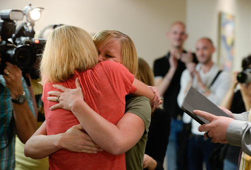 Francisco Kjolseth  |  The Salt Lake Tribune Lynda Coleman, left, and Alisha Matthews embrace after being pronounced married at the Salt Lake County Complex on Monday. The U.S. Supreme Court declined to review all five pending same-sex marriage cases on Monday, Oct. 6, 2014 effectively legalizing gay and lesbian unions, clearing the way for such marriages to proceed in 11 new states - including Utah.