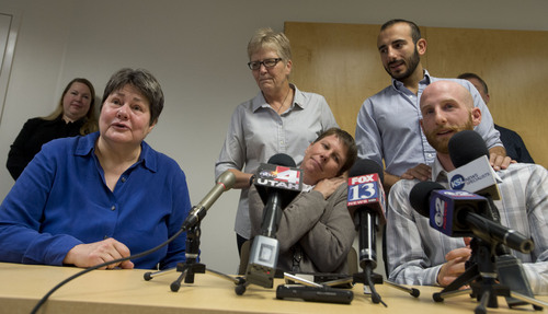 Steve Griffin  |  The Salt Lake Tribune  Kate Call, who is married to Karen Archer,  and couples Laurie Wood, top center, and Kody Partridge, and Moudi Sbeity, top right, and Derek Kitchen address the media during a press conference at Magleby and Greenwood law offices in Salt Lake City, Monday, October 6, 2014.