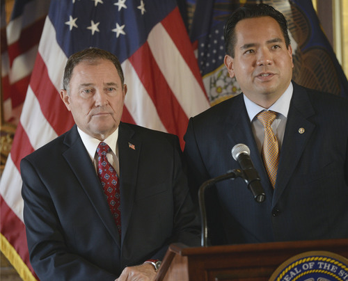 Al Hartmann  |  The Salt Lake Tribune Utah Governor Gary Herbert, left, and Utah Attorney General Sean Reyes speak at a press conference at the state Capitol Monday October 6, 2014, regarding the U.S. Supreme Court's decision not to hear the state's argument in its defense of marriage law, which now opens the door for same-sex marriage in the state of Utah.
