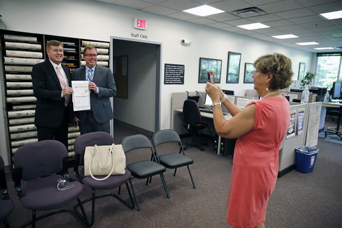FILE - In this June 26, 2014 file photo, longtime same-sex couple Kevin Stalder, far left, and Brad Moses smile as Moses' mother Dianne Lynch takes their picture with their new marriage license, inside the offices of the Boulder County Clerk and Recorder, in Boulder, Colo. The Supreme Court cleared the way Monday, Oct. 6, 2014, for an immediate expansion of same-sex marriage by unexpectedly and tersely turning away appeals from five states seeking to prohibit gay and lesbian unions. The court's order effectively makes gay marriage legal now in 30 states.  (AP Photo/Brennan Linsley, file)