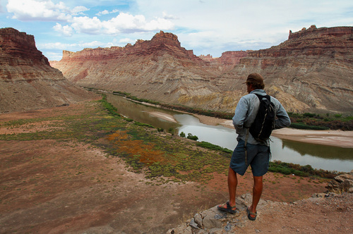 Francisco Kjolseth  |  The Salt Lake Tribune River guide Alex Jahp takes in the scenery of Spanish Bottom in Cataract Canyon during a steep hike up to the colorful crags and pointed pinnacles of the Doll House beyond the rim.