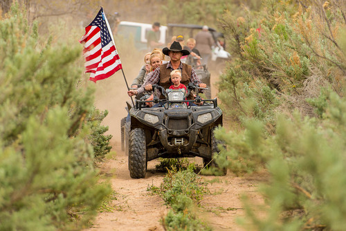 Trent Nelson  |  The Salt Lake Tribune Ryan Bundy rides an ATV through Recapture Canyon, which has been closed to motorized use since 2007, after a call to action by San Juan County Commissioner Phil Lyman. Saturday May 10, 2014 north of Blanding.  Lyman is among five Utahns charged Wednesday with conspiracy in connection with a May 10 ATV ride into Recapture Canyon protesting federal oversight of public land. The BLM had closed this canyon outside Blanding to protect its archaeological resources from motorized use. About 50 people rode into the canyon that day, but only those suspected of organizing or promoting the event were charged.