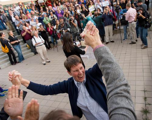 Trent Nelson  |  The Salt Lake Tribune Kitchen v. Herbert plaintiff Kody Partridge celebrates during a rally to celebrate today's legalization of same-sex marriage, Monday October 6, 2014 in Salt Lake City.