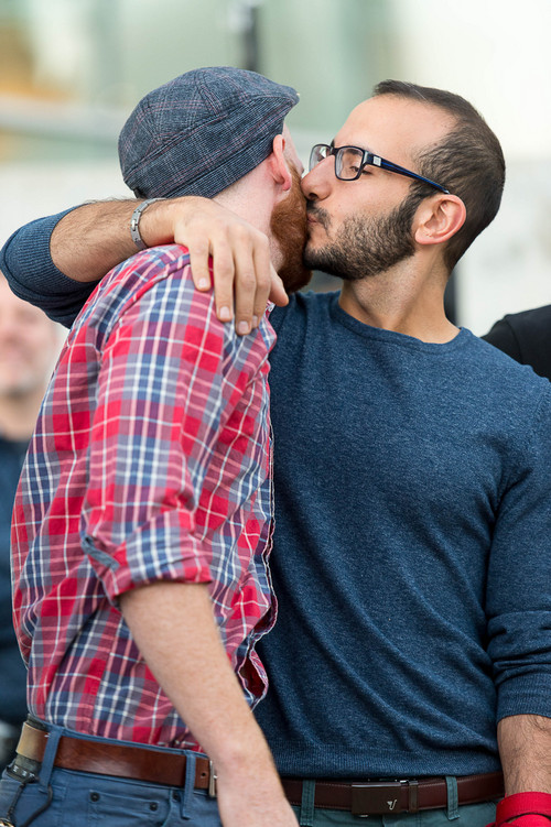 Trent Nelson  |  The Salt Lake Tribune Kitchen v. Herbert plaintiffs Derek Kitchen and Moudi Sbeity celebrate at a rally to celebrate today's legalization of same-sex marriage, Monday October 6, 2014 in Salt Lake City.