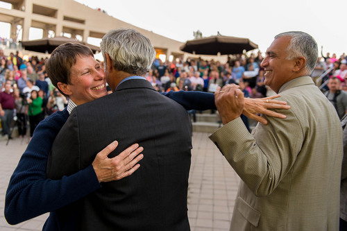 Trent Nelson  |  The Salt Lake Tribune Kitchen v. Herbert plaintiff Kody Partridge hugs Salt Lake City Mayor Ralph Becker and reaches out to Salt Lake County District Attorney Sim Gill during a rally to celebrate today's legalization of same-sex marriage, Monday October 6, 2014 in Salt Lake City.
