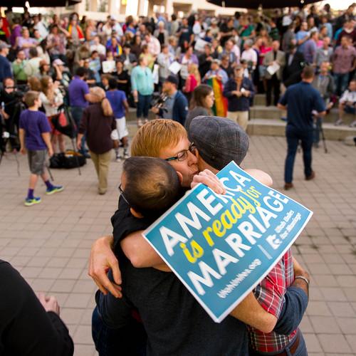 Trent Nelson  |  The Salt Lake Tribune Debbie Johnson embraces Kitchen v. Herbert plaintiffs Derek Kitchen and Moudi Sbeity at a rally to celebrate today's legalization of same-sex marriage, Monday October 6, 2014 in Salt Lake City.