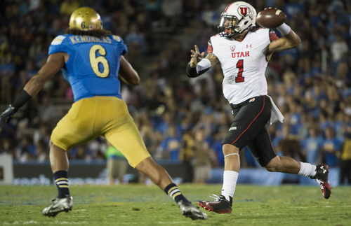 Rick Egan  |  The Salt Lake Tribune  UCLA Bruins linebacker Eric Kendricks (6) goes after Utah Utes quarterback Kendal Thompson (1) fakes a throw, as he runs for a first down, at the Rose Bowl in Pasadena, Saturday, October 4, 2014