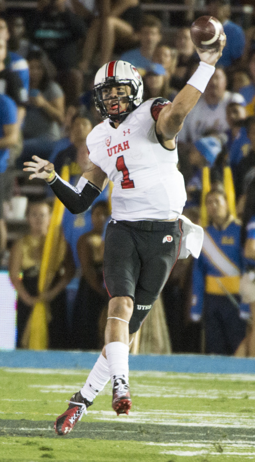 Rick Egan  |  The Salt Lake Tribune  Utah quarterback Kendal Thompson (1) throws or the Utes, as they face UCLA, at the Rose Bowl in Pasadena, Saturday, October 4, 2014