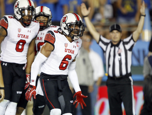 Utah wide receiver Dres Anderson (6) celebrates scoring a touchdown with wide receiver Kaelin Clay (8) during the first half of an NCAA college football game against UCLA on Saturday, Oct. 4, 2014, in Pasadena, Calif. (AP Photo/Alex Gallardo)
