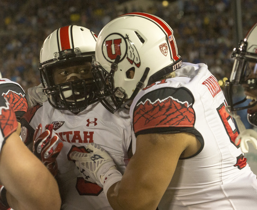 Rick Egan  |  The Salt Lake Tribune   Ute defensive back Tevin Carter (9) is congratulated by defensive end Jason Fanaika (51) after he intercepted a UCLA pass for a touchdown, as the Utah Utes  vs. UCLA Bruins, at the Rose Bowl in Pasadena, Saturday, October 4, 2014