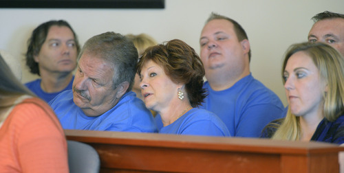 Al Hartmann  |  The Salt Lake Tribune Family and supporters of former West Valley City police officer Shaun Cowley (dressed in blue shirts) listen to testimony in his three-day preliminary hearing in Judge L.A. Dever's courtroom in Salt Lake City Monday October 6, 2014.  Cowley is charged with second-degree felony manslaughter in the Nov. 2, 2012, fatal shooting of 21-year-old Danielle Willard.