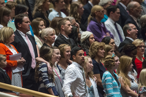 Chris Detrick  |  The Salt Lake Tribune Members of the congregation sing during the morning session of the 184th Semiannual General Conference of The Church of Jesus Christ of Latter-day Saints at the Conference Center in Salt Lake City Saturday October 4, 2014.