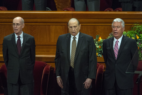 Chris Detrick  |  The Salt Lake Tribune Elder Henry B. Eyring, LDS President Thomas S. Monson and President Dieter F. Uchtdorf sing during the morning session of the 184th Semiannual General Conference of The Church of Jesus Christ of Latter-day Saints at the Conference Center in Salt Lake City Saturday October 4, 2014.