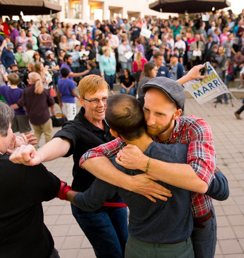Trent Nelson     The Salt Lake Tribune Debbie Johnson rushes in to embrace Kitchen v. Herbert plaintiffs Derek Kitchen and Moudi Sbeity at a rally to celebrate today's legalization of same-sex marriage, Monday October 6, 2014 in Salt Lake City.