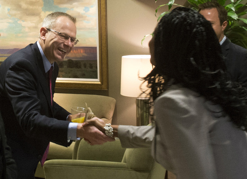 Rick Egan  |  The Salt Lake Tribune  Doug Owens shakes hands with Mia Love before the 4th District candidates answered questions separately at the Salt Lake Chamber of Commerce, Thursday, September 25, 2014