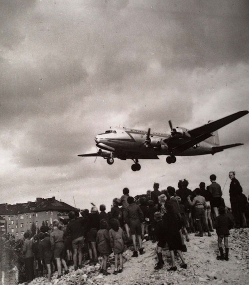 """** FILE ** This undated file photo shows the Douglas C-54 aircraft which was flown by Gail S. Halvorsen during the Berlin Airlift. Lt. Halvorsen earned the nickname of """"The Candyman"""" after he dropped presents of chewing gum to the children of the city. Germany marked the 60th anniversary of the start of the Berlin Airlift on Thursday, June 26, 2008, celebrating an unprecedented undertaking that likely saved the city from falling to the Soviets and helped mend German-American wounds from World War II. (AP Photo/File)"""