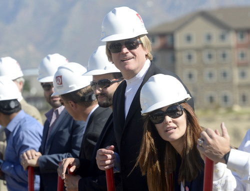 Al Hartmann     The Salt Lake Tribune Overstock.com CEO Patrick Byrne, center, and President Stormy Simon, right, get ready to dig in for the company's ground breaking of a $100 million campus that it is calling the ìPeace Coliseum,î which will cover 230,793 square feet. It will look like a peace sign from overhead and the Roman Colosseum from the ground.  The parcel is on the northwest corner of the property at 7200 S. 900 West
