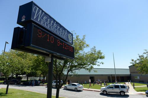 Francisco Kjolseth  |  The Salt Lake Tribune Westbrook Elementary in Taylorsville lets out for the day on September 12, 2014.