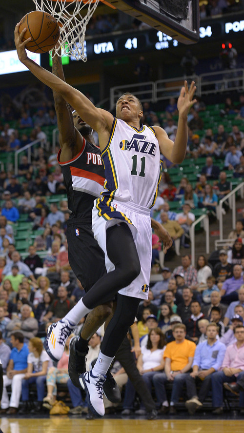 Leah Hogsten  |  The Salt Lake Tribune Utah Jazz guard Dante Exum (11)drives to the net ahead of Portland Trail Blazers guard Will Barton (5). Utah Jazz lead the Portland Blazers 45-34 during Tuesday's, October 7, 2014 preseason opener at Energy Solutions Arena.