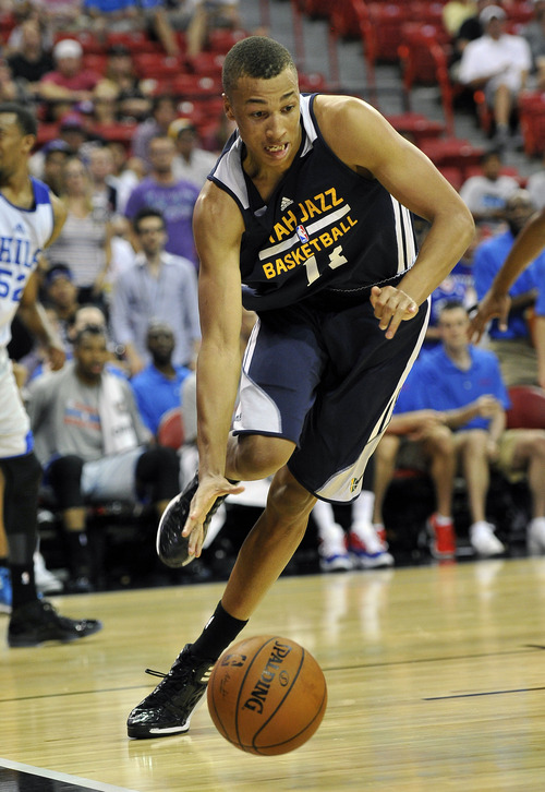 Utah Jazz's Dante Exum drives to the hoop against the Philidelphia 76ers during an NBA summer league basketball game on Saturday, July 12, 2014, in Las Vegas. (AP Photo/David Becker)