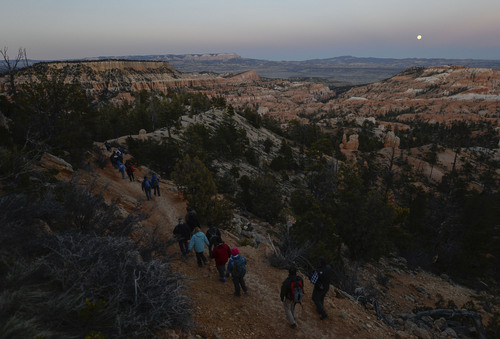 Franciso Kjolseth     The Salt Lake Tribune Bryce Canyon Dark Ranger Kevin Poe leads a group of visitors on full moon walk and the rare treat of experiencing a blood moon during a lunar eclipse in a location famed for its dark skies.