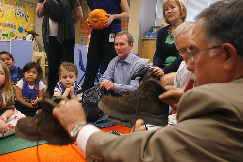 Scott Sommerdorf      Tribune file photo   Salt Lake County Mayor Ben McAdams, center, watches as Councilman Sam Granato, right, acts out a scary part of a story in a Granite School district preschool program funded in part through the county's 'Pay for Success' program. The county is expanding the initiative into other programs where an upfront investment could have long-term cost savings.