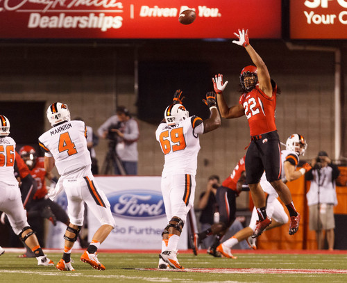 Trent Nelson  |  The Salt Lake Tribune Utah Utes defensive end Thretton Palamo (22) leaps up, but Oregon State Beavers quarterback Sean Mannion's pass sails over him as the University of Utah hosts Oregon State, college football at Rice Eccles Stadium Saturday, September 14, 2013 in Salt Lake City.