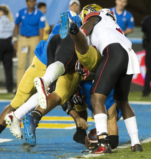 Rick Egan  |  The Salt Lake Tribune  Utah linebacker Jared Norris (41) and  Utah Utes defensive back Andre Godfrey (7) sack UCLA Bruins quarterback Brett Hundley (17) near the end zone the third play in a row in Pac-12 action at the Rose Bowl, Saturday, October 4, 2014