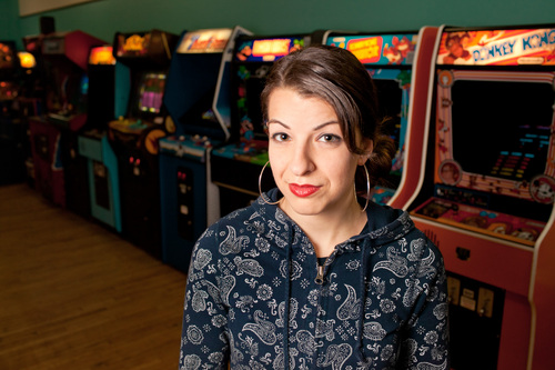 Alex Lazara  |  Courtesy Feminist Frequency Anita Sarkeesian at The Rusty Quarters Retro Arcade & Museum in Minneapolis. Sarkeesian canceled a speech scheduled for Wednesday at Utah State University.