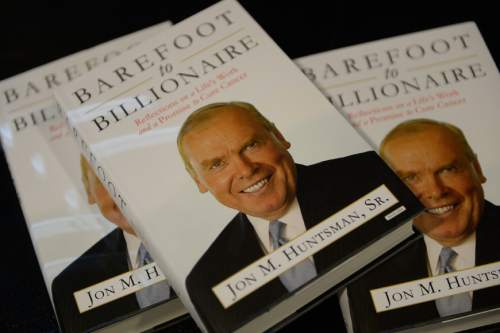 "Francisco Kjolseth  |  The Salt Lake Tribune Jon Huntsman Sr. and Mary Beckerle, CEO of Huntsman Cancer Institute, held a press conference to announce the release of Huntsman's autobiography, ""Barefoot to Billionaire,"" which was followed by a book signing at Deseret Book in downtown Salt Lake City on Friday, Oct. 3. 2014."